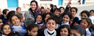 One of our volunteers with students from the UNRWA